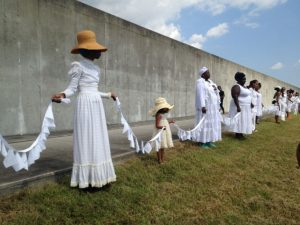 Ecohybridity performs along a Lower Ninth Ward floodwall. (Credit: Ecohybridity)