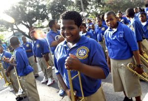 Jordan Jones, center, of the Sophie B. Wright Charter School Marching Band, smiles after performing at the Tipitina Foundation's instrument give-away, Tuesday, Aug. 29, 2006, in New Orleans. The foundation is giving $500,000 worth of instruments to 11 school music programs. (AP Photo/Cheryl Gerber)